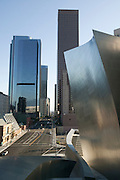 Sharp angles of Walt Disney Concert Hall jut out with a view of downtown LA with blue sky above, 135 North Grand Ave, Los Angeles, CA 90012, Part of Music Center, Performing Arts Center of Los Angeles County, California...Subject photograph(s) are copyright Edward McCain. All rights are reserved except those specifically granted by Edward McCain in writing prior to publication...McCain Photography.211 S 4th Avenue.Tucson, AZ 85701-2103.(520) 623-1998.mobile: (520) 990-0999.fax: (520) 623-1190.http://www.mccainphoto.com.edward@mccainphoto.com.