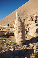Statue head of  Antiochus, the 62 BC Royal Tomb of King Antiochus I Theos of Commagene, west Terrace, Mount Nemrut or Nemrud Dagi summit, near Adıyaman, Turkey .<br /> <br /> If you prefer to buy from our ALAMY PHOTO LIBRARY  Collection visit : https://www.alamy.com/portfolio/paul-williams-funkystock/nemrutdagiancientstatues-turkey.html<br /> <br /> Visit our CLASSICAL WORLD HISTORIC SITES PHOTO COLLECTIONS for more photos to download or buy as wall art prints https://funkystock.photoshelter.com/gallery-collection/Classical-Era-Historic-Sites-Archaeological-Sites-Pictures-Images/C0000g4bSGiDL9rw
