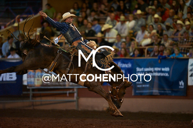 Saddle bronc rider Nick LaDuke of Livermore, CA rides Chestnut Fringe at the Pikes Peak or Bust Rodeo in Colorado Springs, CO.<br /> <br /> <br /> UNEDITED LOW-RES PREVIEW<br /> <br /> <br /> File shown may be an unedited low resolution version used as a proof only. All prints are 100% guaranteed for quality. Sizes 8x10+ come with a version for personal social media. I am currently not selling downloads for commercial/brand use.