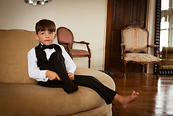 little boy dressing for a formal event