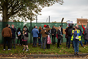 'Welcome To Folkestone' About 400 local residents and community groups including Kent Refugee Action Network and Samphire came together outside Napier Barracks to show the people staying there that they are welcome to the town on the 17th of October 2020 in Folkestone, United Kingdom. In September 2020 Napier Barracks a former military camp was transformed into an assessment and dispersal facility for 400 asylum seekers by the Home Office. (photo by Andrew Aitchison / In Pictures via Getty Images)