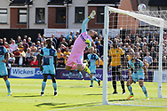 Wycombe Wanderers goalkeeper Scott Brown saves from close range to deny Newport a goal.  EFL Skybet football league two match, Newport county v Wycombe Wanderers at Rodney Parade in Newport, South Wales on Saturday 9th September 2017.<br /> pic by Andrew Orchard, Andrew Orchard sports photography.