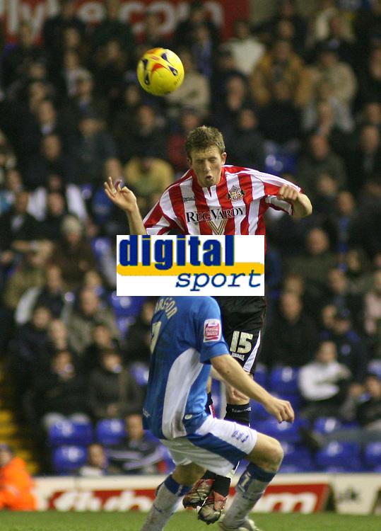 Photo: Mark Stephenson.<br /> Birmingham City v Sunderland. Coca Cola Championship. 20/02/2007.Sunderland's Danny Collins beats Birimingham's  Sebastian Larsson to the ball
