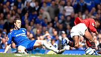 Photo: Daniel Hambury.<br />Chelsea v Manchester United. The Barclays Premiership. 29/04/2006.<br />Chelsea's John Terry tackles United's Louis Saha.