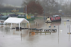 © Licensed to London News Pictures 28/12/2020.        Wateringbury, UK. A flooded picnic area. The River Medway in Kent has burst its banks in Wateringbury near the Medway Wharf Marina. Photo credit:Grant Falvey/LNP