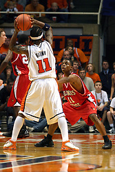 02 January 2004  Vince Greene keeps Dee Brown in check. Illinois State University ties up The Fightin Illini in regulation but fails to top the Big 10 team in overtime. Action took place at the Assembly Hall on the University of Illinois Campus in Champaign - Urbana Illinois.