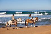 Horseback riders at Las Marias beach in Rincon Puerto Rico