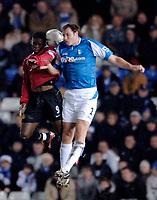 Photo: Glyn Thomas.<br />Birmingham City v Manchester United. Carling Cup.<br />20/12/2005.<br /> Manchester United's Louis Saha (L) and Birmingham's Martin Taylor both go up for the ball.