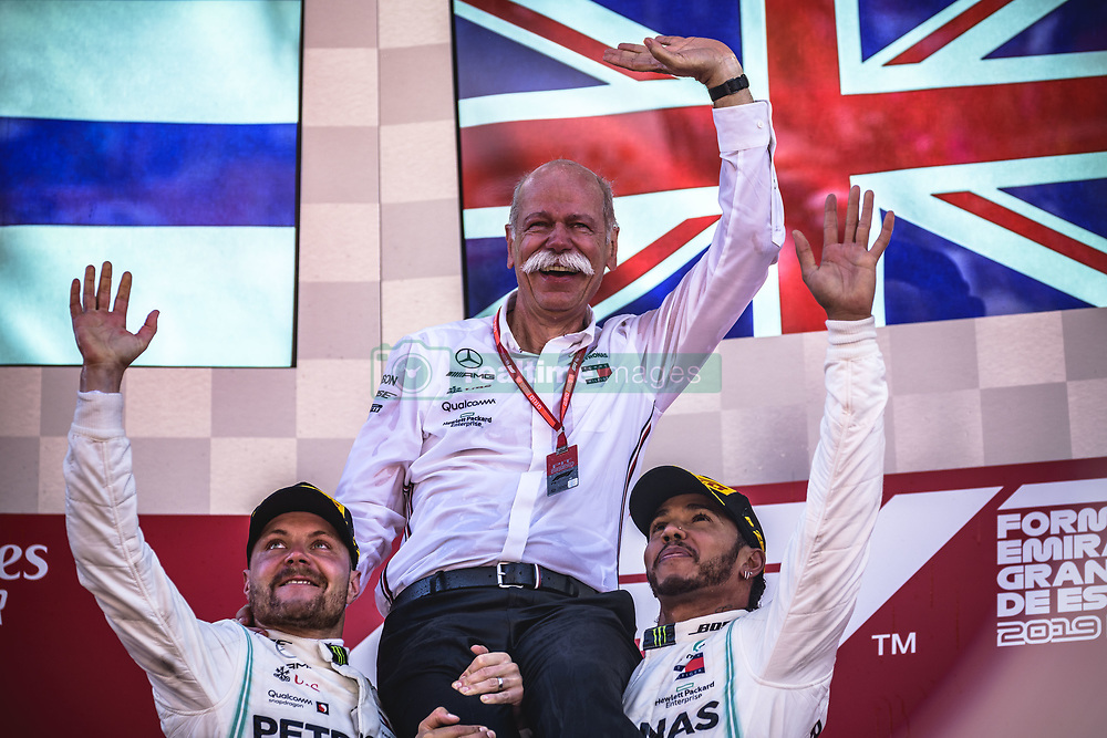 May 12, 2019: Barcelona, Spain: VALTTERI BOTTAS (left) and LEWIS HAMILTON from team AMG Mercedes shoulder Mercedes-Benz boss DIETER ZETSCHE as they celebrate their team victory at the Spanish GP, on the podium at the Circuit de Barcelona-Catalunya. Zetsche is stepping down as CEO of Daimler AG. (Credit Image: © Matthias Oesterle/ZUMA Wire)