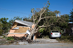 September 13, 2017 - Belle Glade, Florida, U.S. - A mobile home was crushed by a tree felled by Hurricane Irma on NW 12 Street. (Credit Image: © Allen Eyestone/The Palm Beach Post via ZUMA Wire)