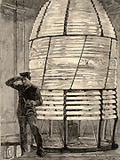 Inside the lantern of the fourth Eddystone lighthouse built on the Stone 13 miles South-east of Polperro, Cornwall, England. Built by  the English civil engineer John Smeaton (1724-1792) beginning in 1756 it was in operation for 127 years.   Engraving from 'The Sea' by F Whymper (London, c1890).