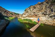 Hiker in Water Canyon, Santa Rosa Island, Channel Islands National Park, California USA