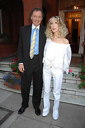 RICHARD & BASIA BRIGGS at a party to celebrate the 21st birthday of one of their horses Leopold, held at 35 Sloane Gardens, London W1 on 10th September 2007.<br />