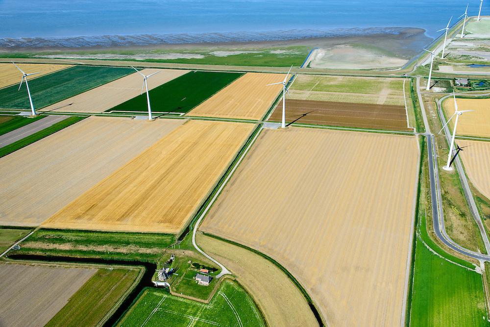 Nederland, Groningen, Gemeente Eemsmond, 05-08-2014;  Emmapolder met windturbines, windmolenpark. In de voorgrond de klassike windmolen De Goliath, een watermolen (poldermolen).<br /> Emmapolder, North Netherland, wind farm. Windmill in the foreground.<br /> luchtfoto (toeslag op standard tarieven);<br /> aerial photo (additional fee required);<br /> copyright foto/photo Siebe Swart
