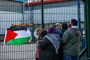 """Leicester, United Kingdom, May 19, 2021: A couple hold their children to send """"heart"""" symbol of love in support of activists who occupied the rooftop of Elbit UAV Tactical Systems factory, In response to Israeli air raids in Gaza, activists from Palestine Action occupied the rooftop of the Meridian Business Park in Braunstone Town, Leicester on Wednesday, May 19, 2021. (Photo by Vudi Xhymshiti/VXP)"""