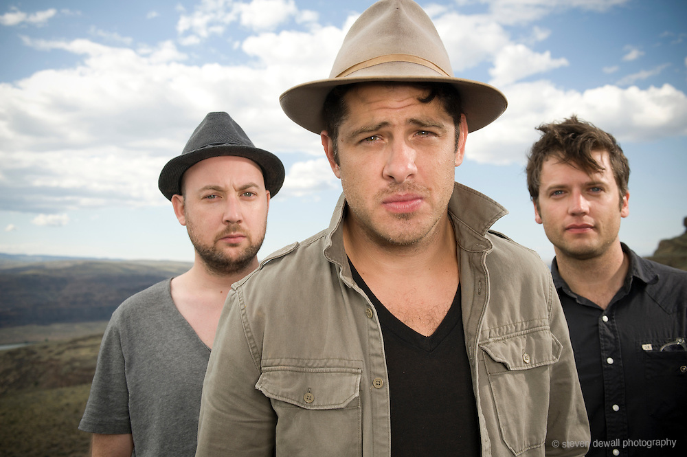 George, WA. - May 27th, 2012 (From left) Rob Allen, Billy McCarthy and Eric Sanderson of We Are Augustines pose for a portrait backstage at the Sasquatch Music Festival in George, WA. United States