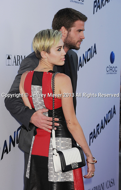 LOS ANGELES, CA- AUGUST 08: Actors Miley Cyrus and Liam Hemsworth arrive at the 'Paranoia' - Los Angeles Premiere at DGA Theater on August 8, 2013 in Los Angeles, California.