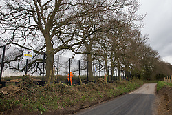 Great Missenden, UK. 9th April, 2021. HS2 security contractors guard a fenced area on Leather Lane where several hundred-year-old oak trees have been felled to enable the construction of a temporary access road and compound for the HS2 high-speed rail link. Following pressure from local residents (over 40,000 people signed a petition to save the trees), Buckinghamshire Council and the Chilterns Conservation Board, it appears that HS2's plans have been changed in such a way as to preserve some of the trees along the wildlife-rich ancient country lane.