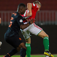 Netherlands' Jetro Willems (L) and Hungary's Vladimir Koman (R) fight for the ball during a World Cup 2014 qualifying soccer match Hungary playing against Netherlands in Budapest, Hungary on September 11, 2012. ATTILA VOLGYI