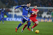 Tony Watt of Cardiff city makes a break past Craig Conway of Blackburn Rovers ®. Skybet football league championship match, Cardiff city v Blackburn Rovers at the Cardiff city stadium in Cardiff, South Wales on Saturday 2nd Jan 2016.<br /> pic by Andrew Orchard, Andrew Orchard sports photography.