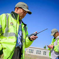 """052015       Cable Hoover<br /> <br /> Base Realignment and Closure site manager Rich Cruz, left, and Corps of Engineers project manager D.J. Myers listen to the """"all clear"""" call as depot personnel prepare to detonate an unexploded ordinance Wednesday at Fort Wingate Army Depot."""