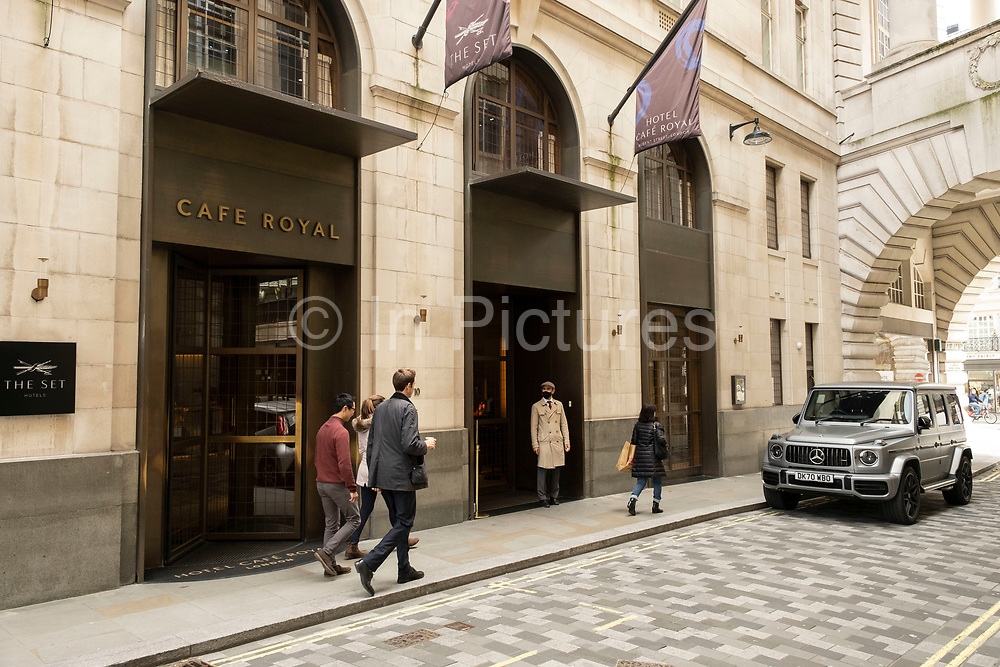 Doorman at the Hotel Cafe Royal on 26th May 2021 in London, United Kingdom. The Hotel Cafe Royal is a five-star hotel at 68 Regent Street in Piccadilly, London. Before its conversion in 2008–2012 it was a restaurant, meeting place and one of the most famous venues in London.