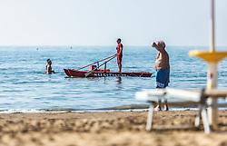 THEMENBILD - ein Rettungsmann auf seinem Boot in Küsten nähe. Lignano ist ein beliebter Badeort an der italienischen Adria-Küste, aufgenommen am 16. Juni 2019, Lignano Sabbiadoro, Italien // a rescue man on his boat near the coast. Lignano is a popular seaside resort on the Italian Adriatic coast on 2019/06/16, Lignano Sabbiadoro, Italy. EXPA Pictures © 2019, PhotoCredit: EXPA/ Stefanie Oberhauser