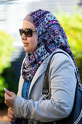 Asmaa Hemdan, plaintiff, arrives at her employment Tribunal at in Watford. Watford, August 03 2018.