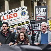 Richard Burgon, Stella Morris and Kristinn Hrafnsson at thge front holding a big banners March for Assange freedom assembly at BBC march to Royal Court of Justice, 23 October 2021, London, UK.