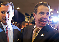 Albertson, New York, U.S. 26th October 2013. R-L, New York Governor ANDREW CUOMO endorses TOM SUOZZI for Nassau County Executive,at the Albertson Veterans of Foreign Wars VFW Post. Democrat Suozzi, the former Nassau County Executive, and Republican incumbent Mangano face each other in a rematch in the upcoming November 5th election.
