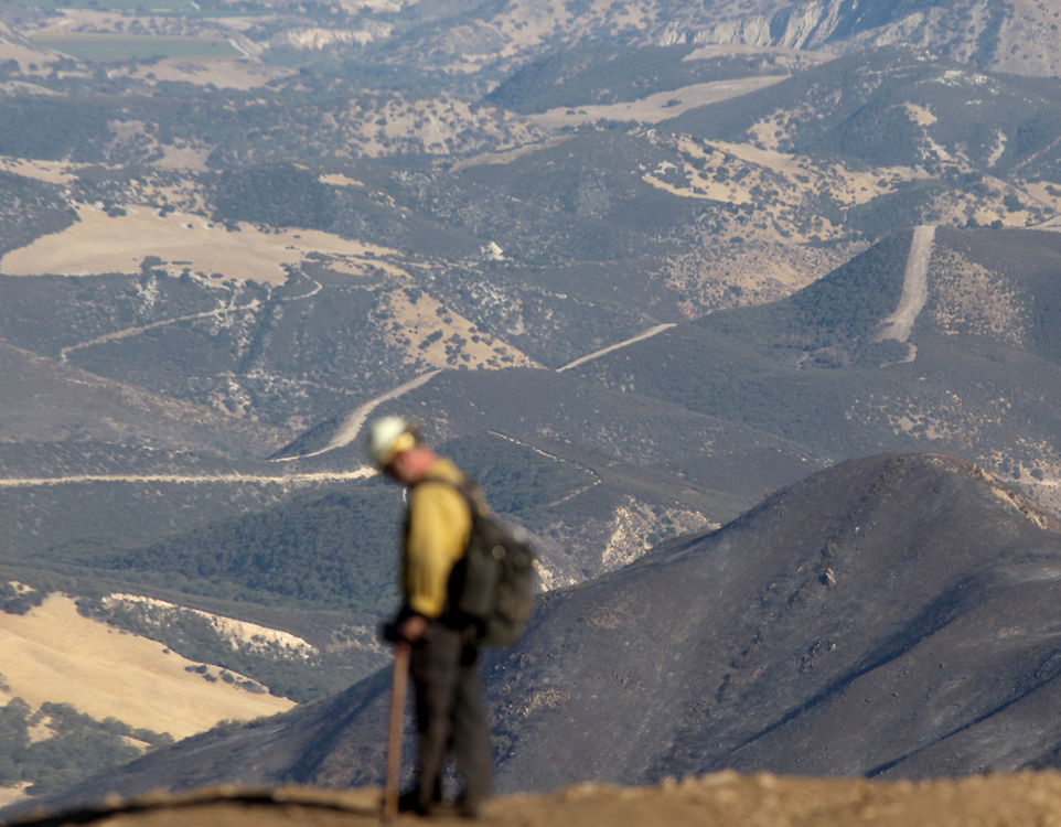 A firefighter looks out from Chews Ridge over the Los Padres National Forest near Big Sur, Calif. on Sept. 24, 2016.