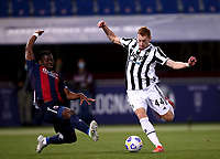 BOLOGNA, ITALY - MAY 23: Dejan Kulusevski of Juventus FC competes for the ball with Adama Soumaoro of Bologna FC ,during the Serie A match between Bologna FC and Juventus FC at Stadio Renato Dall'Ara on May 23, 2021 in Bologna, Italy.(Photo by MB Media/Getty Images)