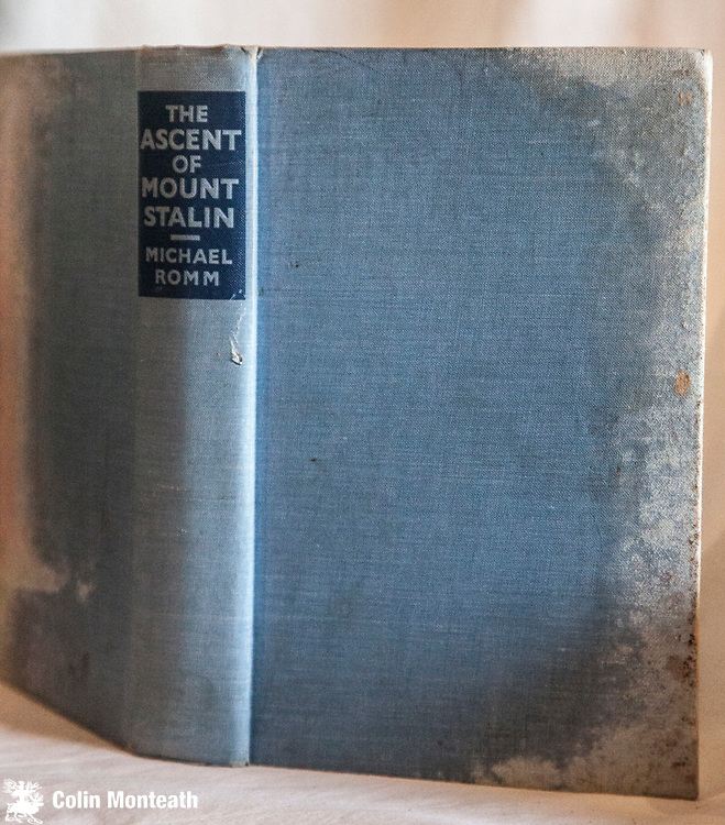 THE ASCENT OF MOUNT STALIN, Michael Romm, Lawrence & Wishart, London, 1933, 1st Uk edn., 270 page hardback, no jacket, front and back boards both water-damaged? binding and spine solid, fold-out map, B&W plates, previous owner's stamp fep.,  An account of the Russian scientific expedition of 1933 which was the first to ascend this 7,495m summit, the highest in the former USSR and now the highest in Tajikistan. The mountain was originally called Garmo Peak, became Mount Stalin in about 1932, Peak Communism in about 1962 and is now called Ismoili Somoni. - scarce $NZ75 (Bill King Collection)