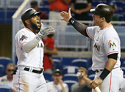 May 31, 2017 - Miami, FL, USA - Miami Marlins first baseman Justin Bour greets left fielder Marcell Ozuna after his two-run home run in the first inning against the Philadelphia Phillies on Wednesday, May 31, 2017 at Marlins Park in Little Havana in Miami, Fla. (Credit Image: © Pedro Portal/TNS via ZUMA Wire)