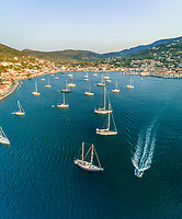 Aerial view of group of boats anchored with speedboat passing in the bay of Ithaki, Greece.