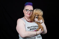 © Licensed to London News Pictures. 10/03/2016. Birmingham, UK. Rebecca Ellis with her Toy Poodle named Charlie at Crufts 2016 held at the NEC in Birmingham, West Midlands, UK. The world's largest dog show, Crufts is this year celebrating it's 125th anniversary. The annual event is organised and hosted by the Kennel Club and has been running since 1891. Photo credit : Ian Hinchliffe/LNP