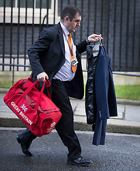 © Licensed to London News Pictures. 18/02/2016. London, UK. A Reiss coat and an Great Britain Team GB holdall thought to belong to Prime Minister David Cameron are loaded into a car as he leaves Downing Street. The Prime Minister is heading to a summit in Brussels to negotiate reforms ahead of a possible referendum on EU membership for the UK. Photo credit: Peter Macdiarmid/LNP