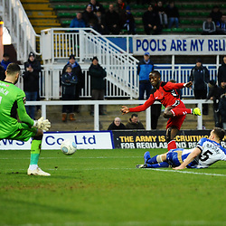 TELFORD COPYRIGHT MIKE SHERIDAN 12/1/2019 - Dan Udoh of AFC Telford shoots under pressure from Carl Magnay during the Vanarama Conference North fixture between AFC Telford United and Hartlepool United at the Super Six Stadium.