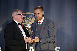 CARDIFF, WALES - Tuesday, November 8, 2016: Wales' Aaron Ramsey receives the Euro 2016 Player of the Tournament award from FAW President David Griffiths during the FAW Awards Dinner at the Vale Resort. (Pic by David Rawcliffe/Propaganda)