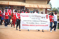 """U.K. soccer club Arsenal and the Rwandan Development Board announced a sponsorship deal in late May 2018 which will see """"Visit Rwanda"""" printed on the sleeves of the Arsenal kit for the next 3 seasons at a cost to the Rwanda Development board of £10million per season. It is  intended to promote tourism to Rwanda. Pictured here Rwanda Arsenal supporters march to remember genocide victims in Kigali May 28th, 2018"""