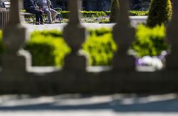 THEMENBILD - Teilansicht von zwei Pensionisten auf einer Bank mit Spazierstock. Das Schloss Mirabell und seine Gärten zählen zu den Touristenzielen in der Stadt, aufgenommen am 09. Mai 2018 in Salzburg, Österreich // Partial view of two pensioners on a bench with walking stick. The Mirabell palace with its gardens is a listed cultural heritage monument and part of the Historic Centre of the City, Salzburg, Austria on 2018/05/09. EXPA Pictures © 2018, PhotoCredit: EXPA/ JFK