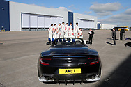 The team prepare for a squad photo in front of an Aston Martin Vanquish S car. Glamorgan CC media day and photocall at Aston Martin, St Athan, near Cardiff , South Wales on Thursday 6th April 2017.<br /> pic by Andrew Orchard, Andrew Orchard sports photography.