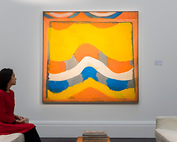 """© Licensed to London News Pictures. 18/11/2016. London, UK. A staff member views """"First Fifth"""" by Richard Smith (est. GBP30-50k), at the preview at Sotheby's of works on view at four upcoming November auctions featuring Modern & Post-War British Art, A Painter's Paradise (Julian Trevelyan & Mary Fedden at Durham Wharf), Scottish Art and Picasso Ceramics from the Lord & Lady Attenborough Private Collection. Photo credit : Stephen Chung/LNP"""