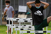 Members of the North Dallas HS Bulldogs football team  go through training drills  on the first day back to school in Texas, since the beginning of the Covid-19 pandemic began. .(Photo by Jaime R. Carrero)