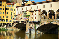 """The medieval The Ponte Vecchio (""""Old Bridge"""") crossing the River Arno in the hiostoric centre of Florence, Italy, UNESCO World Heritage Site. .<br /> <br /> Visit our ITALY PHOTO COLLECTION for more   photos of Italy to download or buy as prints https://funkystock.photoshelter.com/gallery-collection/2b-Pictures-Images-of-Italy-Photos-of-Italian-Historic-Landmark-Sites/C0000qxA2zGFjd_k<br /> .<br /> <br /> Visit our MEDIEVAL PHOTO COLLECTIONS for more   photos  to download or buy as prints https://funkystock.photoshelter.com/gallery-collection/Medieval-Middle-Ages-Historic-Places-Arcaeological-Sites-Pictures-Images-of/C0000B5ZA54_WD0s"""