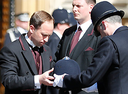 © Licensed to London News Pictures. 09/04/2017. London, UK.  A police helmet belonging to PC Keith Palmer is handed over as the coffin of arrives at Chapel of St Mary Undercroft within the Palace of Westminster, ahead of his funeral tomorrow (Mon). PC Palmer was killed in a terror attack when Khalid Masood drove a car at pedestrians over Westminster Bridge and then attempted to enter Parliament with a knife. Photo credit: Tolga Akmen/LNP