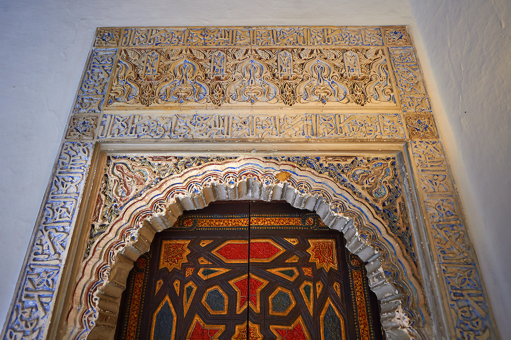 Arabesque Mudjar plasterwork and Zillige tiles of of the 12th century ) Alcazar of Seville, Seville, Spain . The Royal Alcázars of Seville (al-Qasr al-Muriq ) or Alcázar of Seville, is a royal palace in Seville, Spain. It was built by Castilian Christians on the site of an Abbadid Muslim alcazar, or residential fortress.The fortress was destroyed after the Christian conquest of Seville The palace is a preeminent example of Mudéjar architecture in the Iberian Peninsula but features Gothic, Renaissance and Romanesque design elements from previous stages of construction. The upper storeys of the Alcázar are still occupied by the royal family when they are in Seville. <br /> <br /> Visit our SPAIN HISTORIC PLACES PHOTO COLLECTIONS for more photos to download or buy as wall art prints https://funkystock.photoshelter.com/gallery-collection/Pictures-Images-of-Spain-Spanish-Historical-Archaeology-Sites-Museum-Antiquities/C0000EUVhLC3Nbgw <br /> .<br /> Visit our MEDIEVAL PHOTO COLLECTIONS for more   photos  to download or buy as prints https://funkystock.photoshelter.com/gallery-collection/Medieval-Middle-Ages-Historic-Places-Arcaeological-Sites-Pictures-Images-of/C0000B5ZA54_WD0s