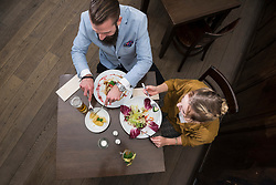 Top view of couple eating at restaurant