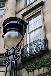 Detail of ornate street lamp and stone Georgian house in historic New Town of Edinburgh in Scotland