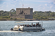 The park service ferry boat takes visitors to the historic Fort Matanzas National Monument on the Matanzas River in St Augustine, Florida. The stone coastal fort was built in 1742 by the Spanish to guard the Matanzas Inlet.